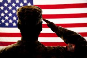Patriotism: Military woman salutes American flag. Silhouette.